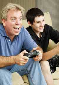 father-and-son-laughing-and-playing-video-games