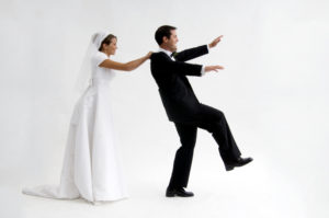 Bride grabs groom as he has second thoughts
